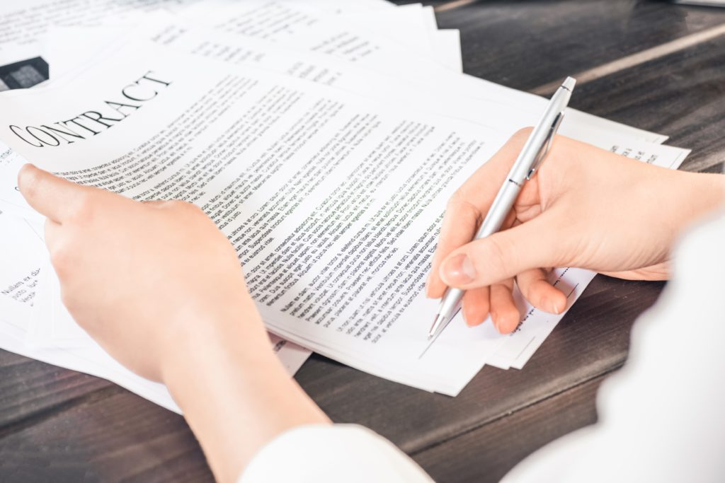 Woman signs a ghostwriting contract