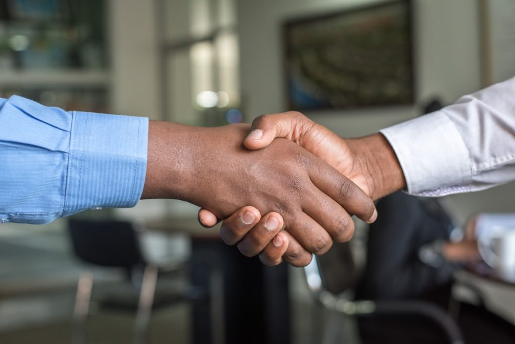Hire a ghostwriter with a handshake and a contract